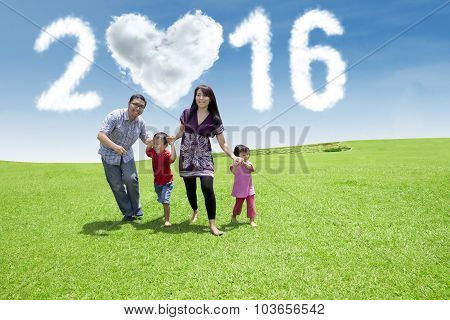 Parents And Children Running Under Numbers 2016