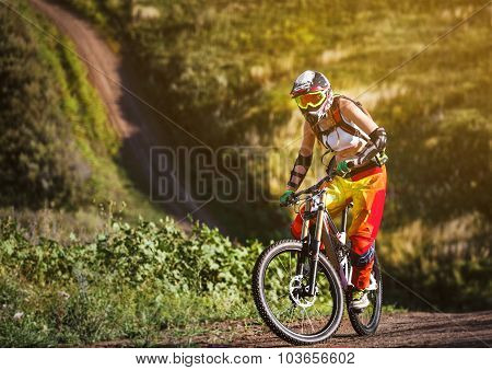 Extreme Sports - Young Woman Riding Downhill Bike
