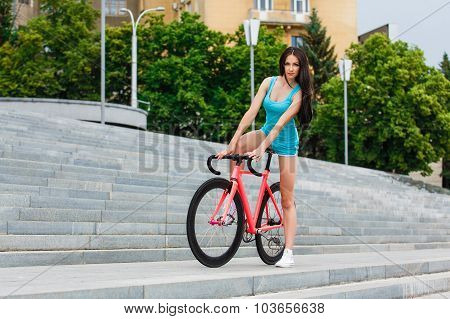Young Slim Sexy Sportive Woman On Bicycle