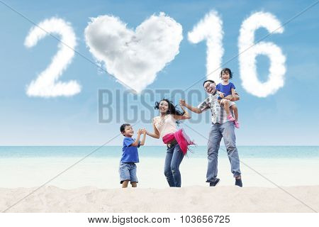 Playful Family On Beach With Numbers 2016