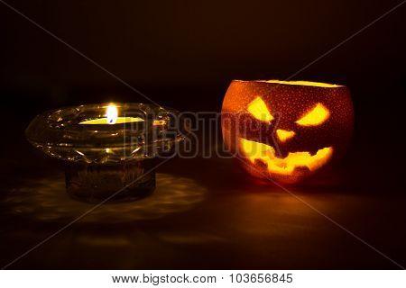 Halloween Orange Fruit Jack  Lantern With Candle On Dark