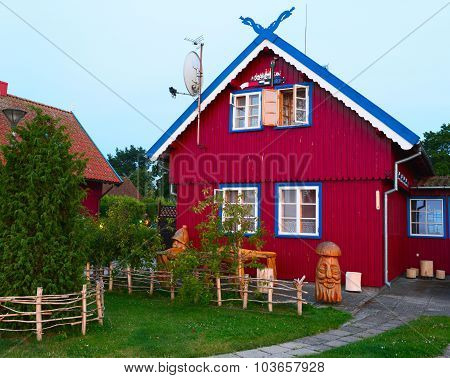 Colorful traditional residential house. Early morning in the town of Nida