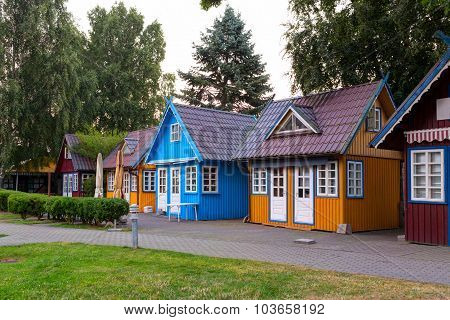 Traditional colorful souvenir houses on the shopping street in the town of Nida