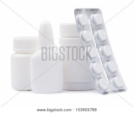 Bottles of medicines and pills in a blister pack