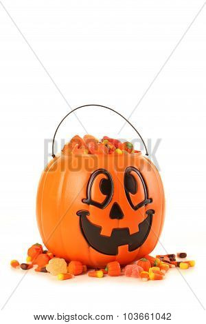 Halloween Pumpkin Basket Full Of Candies Isolated On A White