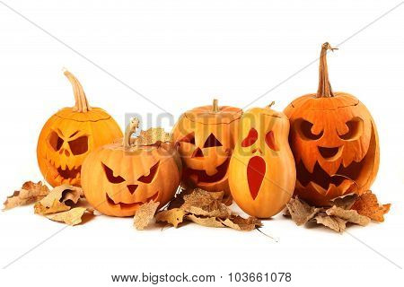 Halloween Pumpkins With Dry Leafs Isolated On A White