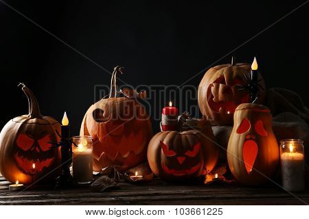 Halloween Pumpkins With Candle On Brown Wooden Table