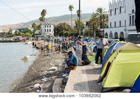 KOS, GREECE - SEP 27, 2015: Tents of war refugees in the port of Kos island. Kos is located just 4 km from the Turkish coast, and many refugees come from Turkey in an inflatable boats.