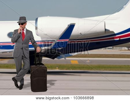 Business man standing next to a private jet