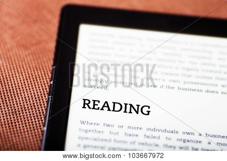 Reading On Ebook, Tablet Concept