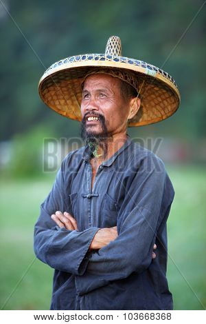 Guangxi - June 18: Chinese Man In Old Hat In Guangxi Region, Traditional Type Of Man Face In China,