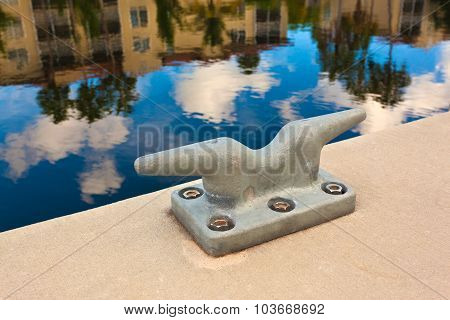 Metal cleat on a concrete dock