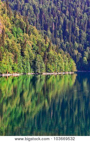 Scenery view of colorful mountain lake with crystal water and beautful reflections Ritsa lake Abkhazia