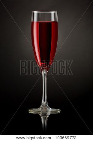 Champagne glass with red drink
