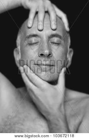Man holding his head in an artistic way