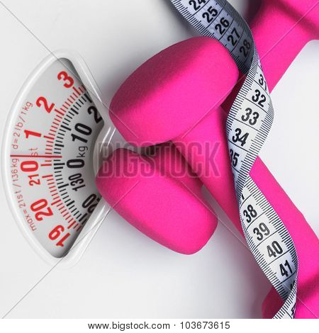 Dumbbell Measuring Tape On Weight Scale. Fitness