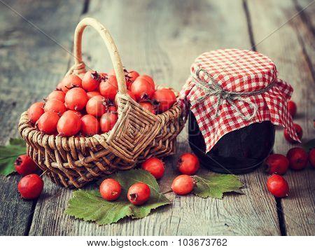 Jar Of Jam And Hawthorn Berries In Basket On Rustic Table