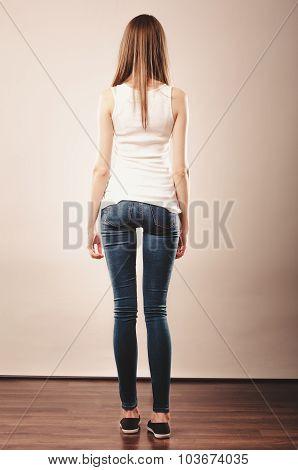 Girl Full Length In Denim Trousers White Blank Top Rear View