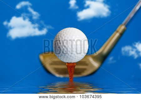 Golf ball on the tee over water