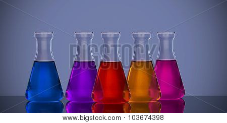 Back lit laboratory flasks in different colors