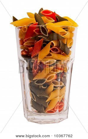 Glass full of colored italian pasta