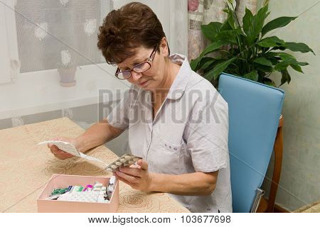 elderly woman with pills and instructions