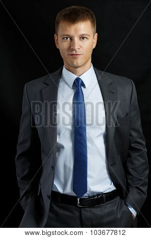 Businessman In Suit And Tie Standing