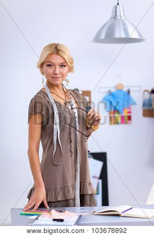 Clothes designer at work in her office