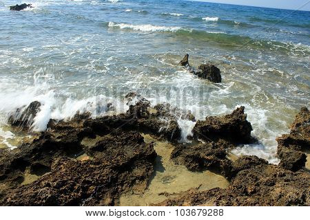 Rocks being hit by waves