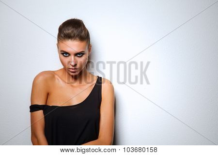 Studio shot of a beautiful young woman wearing smokey eyes makeup