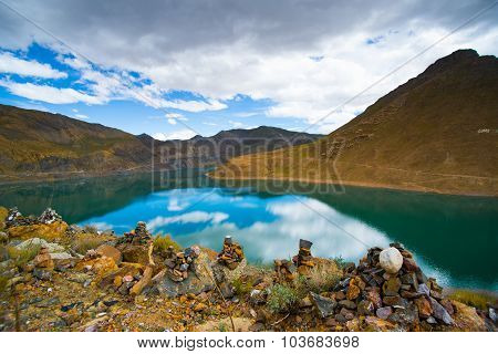 Beautiful landscape with lake, mountain and pile of stone in Tibet, China.