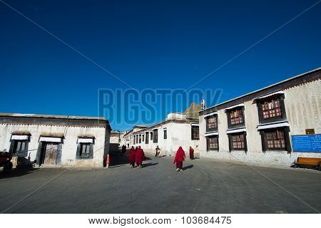 Monks walk in Tashilhunpo monastery in Shigatse, Tibet.