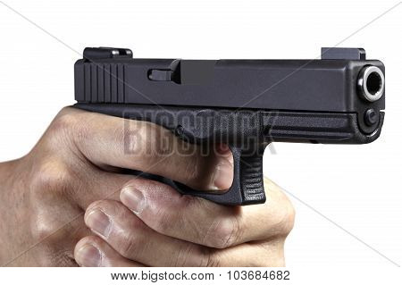 Hands gripping and aiming handgun weapon