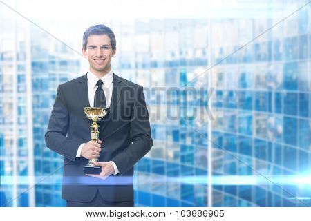 Executive keeping gold cup, blue background. Concept of victory and success
