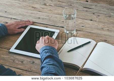 Male Finger Clicks On Screen Tablet Computer Closeup