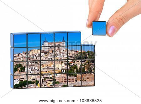 Hand and Toledo Spain (my photo) puzzle isolated on white background