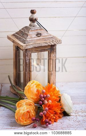 Autumn Still Life Photo With Flowers  In Yellow Colors And Candle