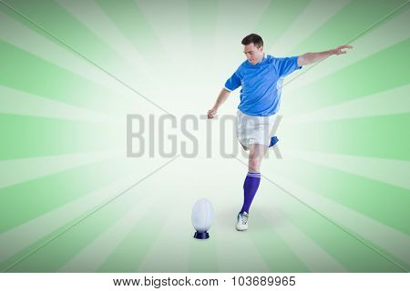 Rugby player doing a drop kick against linear design