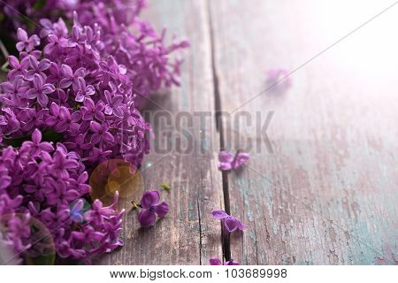 Lilac Flowers On  Vintage  Wooden Background.