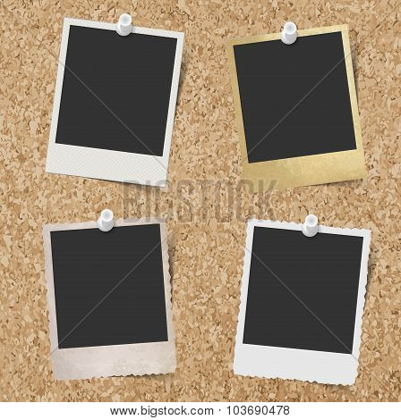 Blank instant photo frames pinned to cork board background