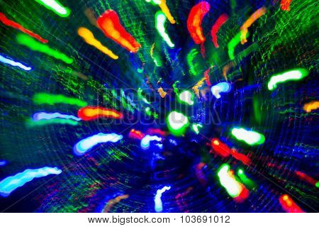 holidays, illumination and electricity concept - bright and colorful firework lights over black background
