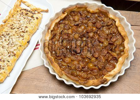 Tart Plums And Chocolate Pastry On A Towel