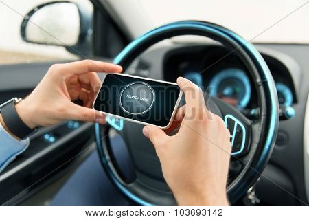 transport, business trip, technology and people concept -close up of male hands with navigation icon on smartphone screen in car