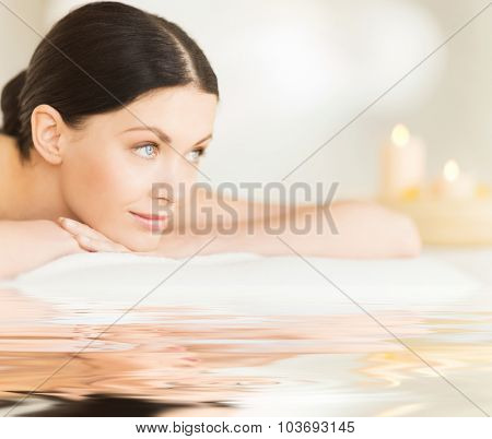 picture of happy relaxed woman in spa salon