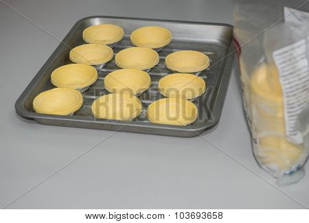 Preparing Egg Tarts For Baking
