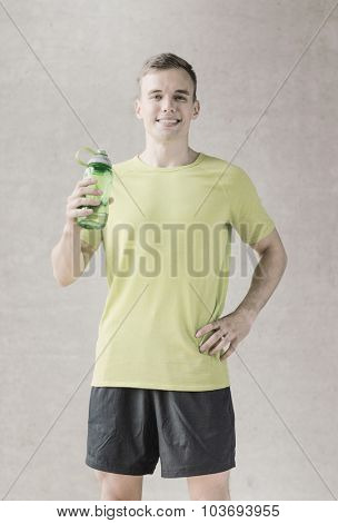 sport, fitness, lifestyle and people concept - smiling man with bottle of water in gym