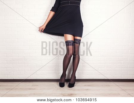 woman legs in elegant black high heel shoes