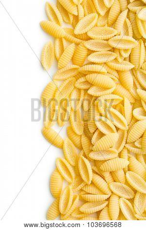 uncooked italian pasta on white background