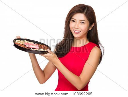 Chinese young woman hold with snack tray for lunar new year