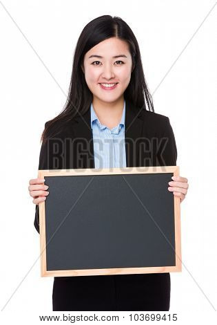 Asian young businesswoman show with the chalkboard